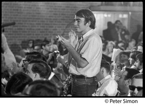Thumbnail of Audience member applauding at the National Student Association Congress, watching debate between             Timothy Leary and Sidney Cohen on 'social philosophy'