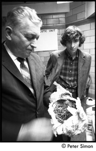 Thumbnail of Stephen Davis watches wide-eyed as narcotics officer Duncan MacNeil unwraps a tinfoil-wrapped package of drugs