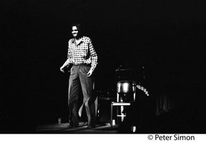 Thumbnail of James Taylor on stage Probably taken at Radio City Music Hall concert, November 4, 1972