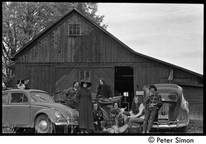 Thumbnail of Commune members gathered around their vehicles outside the barn, Packer Corners             commune Group includes: Raymond Mungo (far left) and Michael Gies (far right) and             seated (l. to r.) John Wilton, Elliot Blinder, Verandah Porche, and Lacey Mason