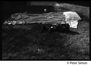 Thumbnail of Sanctuary movement and occupation of Marsh Chapel, Boston University Blanket, pillow, and personal effects on the lawn outside Marsh Chapel