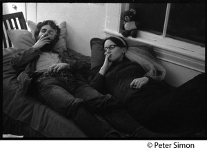 Thumbnail of Students reclining on a bed, smoking cigarettes