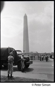Thumbnail of National guardsmen and truck at the ready during the March on the Pentagon (mobilization on             Washington), the Washington Monument in the background
