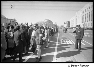 Thumbnail of Protesters lined up along Pennsylvania Avenue, with police keeping order: Vietnam             Moratorium march on Washington