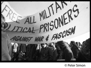 Thumbnail of Protesters beneath a banner 'Free all military political prisoners... against war             & fascism' (re. Fort Dix antiwar soldiers): Vietnam Moratorium march on Washington