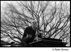Thumbnail of Benjamin Spock speaking at the podium: Vietnam Moratorium march on Washington