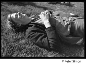 Thumbnail of Livingston Taylor, lying on the lawn, smoking a cigarette