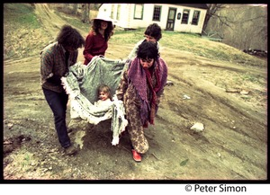 Thumbnail of A Fambly trip, May Day Clockwise from left: Tim Rossner, Catherine Blinder, Jenny Buell, and unidentified woman carrying             a child  in a blanket near Tree Frog Farm commune