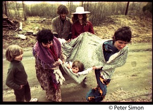 Thumbnail of A Fambly trip, May Day Clockwise from rear: Tim Rossner, Catherine Blinder, Jenny Buell, and unidentified woman carrying             a child  in a blanket near Tree Frog Farm commune
