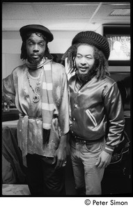 Thumbnail of Peter Tosh (let) and unidentified man back stage before his appearance on Saturday Night Live