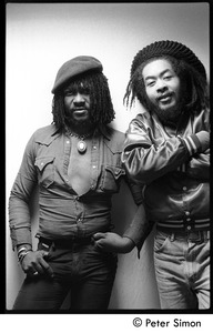 Thumbnail of Sly Dunbar (let) and unidentified man: double portrait back stage before             appearance with Peter Tosh on Saturday Night Live