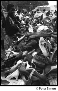 Thumbnail of Resurrection City: young boy looks over a pile of shoes