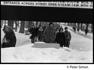 Thumbnail of Group of protesters walking along a path in the Boston Common near Park Street             Station: Resistance antiwar rally