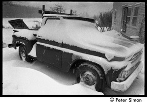 Thumbnail of Pickup truck buried in snow during a winter storm, Packer Corners commune