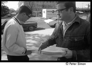 Thumbnail of Sanctuary movement and occupation of Marsh Chapel Supporter distributing literature in front of the Chapel