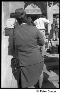 Thumbnail of Sanctuary movement and occupation of Marsh Chapel A woman in a uniform watches the press cover events outside the Chapel