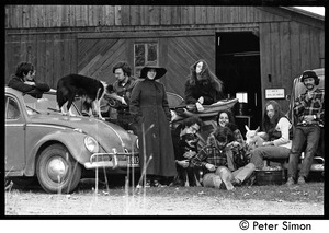 Thumbnail of Commune members gathered around their vehicles outside the barn, Packer Corners             commune Group includes (l. to r.): Raymond Mungo, Alex Kelly, unidentified, John             Wilton, unidentified, Elliot Blinder, Verandah Porche, Lacey Mason, Michael Gies