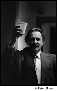 Thumbnail of Unidentified man backstage at Saturday Night Live, holding a cup