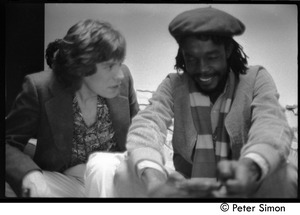 Thumbnail of Mick Jagger and Peter Tosh talking backstage during an appearance on Saturday Night Live