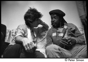 Thumbnail of Keith Richards (left) talking with Peter Tosh backstage during an appearance on Saturday Night Live