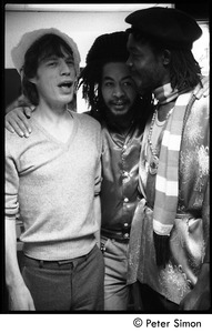 Thumbnail of Mick Jagger, unidentified man, and Peter Tosh (l. to r.) backstage on Saturday Night Live:             three-quarter length portrait