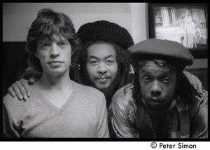 Thumbnail of Mick Jagger, unidentified man, and Peter Tosh (l. to r.) backstage on Saturday Night Live:             close-up portrait