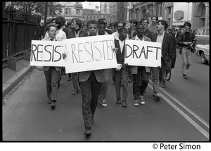 Thumbnail of Resistance rally: anti-draft and anti-Vietnam war protesters marching on Boylston Street near Emerson College Young African American men lead the pack carrying signs reading 'Resist,'             'Resister,' and  'Draft'
