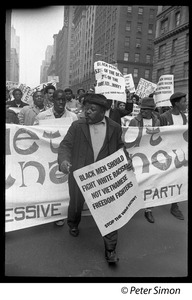 Thumbnail of Harlem Peace March: Progressive Labor Party march behind banner reading 'Get out of Vietnam now' African American antiwar protesters marching through the New York streets,             one with sign reading 'Black men should fight white racism, not Vietnamese freedom             fighters'
