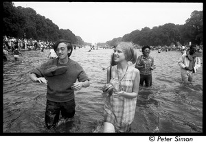 Thumbnail of Splashing in the Reflecting Pond during the Poor Peoples' Campaign Solidarity Day Raymond Mungo, shoes around his neck, with friend Lottie