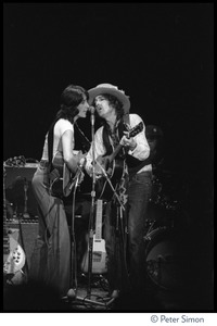 Thumbnail of Joan Baez and Bob Dylan sharing a microphone, performing at the Harvard Square Theater,             Cambridge, with the Rolling Thunder Revue