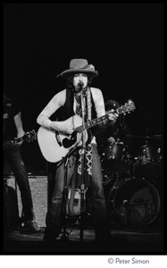 Thumbnail of Bob Dylan performing at the Harvard Square Theater, Cambridge, with the             Rolling Thunder Revue