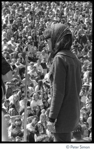 Thumbnail of Jefferson Airplane performing at the Fantasy Fair and Magic Mountain Music             Festival, Mount Tamalpais Grace Slick on stage, with view of the crowd in the background