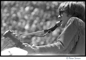 Thumbnail of Jefferson Airplane performing at the Fantasy Fair and Magic Mountain Music             Festival, Mount Tamalpais Paul Kantner in buckskin fringe, playing guitar and singing