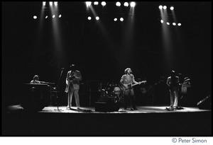 Thumbnail of Bruce Springsteen and the E Street Band in concert at the Boston Music Hall From left: Danny Federici (keyboards), Clarence Clemons (saxophone), Springsteen, Steve Van             Zandt (guitar)