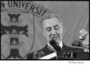 Thumbnail of Sen. Eugene McCarthy speaking at Sargeant Gymnasium, Boston University Close-up of McCarthy speaking at a podium behind a raft of microphones