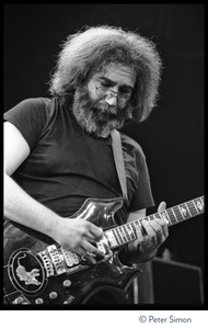 Thumbnail of Jerry Garcia, playing guitar in concert with the Grateful Dead, Radio City Music Hall