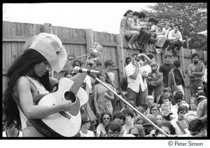 Thumbnail of Buffy Sainte-Marie performing on stage, Newport Folk Festival