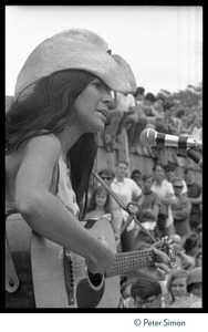 Thumbnail of Buffy Sainte-Marie performing on stage, Newport Folk Festival Close-up of Sainte-Marie