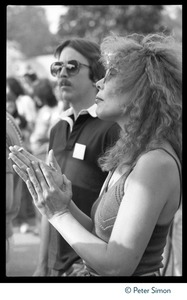Thumbnail of Joni Mitchell applauding at the No Nukes protest and concert