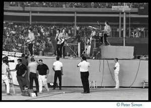 Thumbnail of The  Beatles performing on stage, Shea Stadium concert From left: Paul McCartney, George Harrison, John Lennon, Ringo Starr