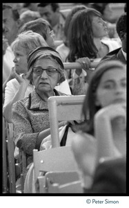 Thumbnail of Elderly woman seated among Beatles fans during concert at Shea Stadium