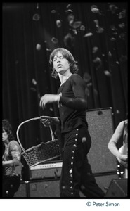 Thumbnail of Mick Jagger (Rolling Stones) performing on stage at the Boston Garden Jagger throws flower petals to the crowd