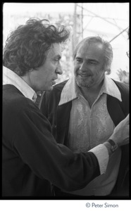 Thumbnail of Bill Graham (left) talking to Marlon Brando Backstage at Graham's SNACK (Students Need Athletics, Culture and Kicks) benefit             concert, Kezar Stadium