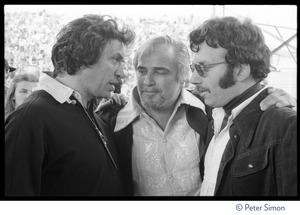 Thumbnail of Bill Graham (left) talking to Marlon Brando and unidentified man Backstage at Graham's SNACK (Students Need Athletics, Culture and Kicks) benefit             concert, Kezar Stadium
