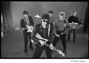 Thumbnail of The  Cars filming 'You Might Think' From left: Elliot Easton, Ric Ocasek, David Robinson, Benjamin Orr, and Greg Hawkes performing in front of a green screen