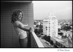 Thumbnail of Robert Plant (Led Zeppelin) looks at Sunset Strip from a balcony at the             Riot House 'As I took this photo on assignment with Stephen Davis for Atlantic Monthly,             Plant shouted out 'I'm a golden god''