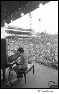 Thumbnail of Bob Dylan playing piano on stage at Bill Graham's SNACK             (Students Need Athletics, Culture and Kicks) benefit concert, Kezar Stadium