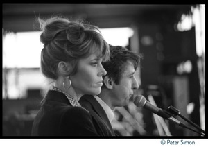 Thumbnail of Jane Fonda and Tom Hayden at the Musicians United for Safe Energy concert Addressing the crowd behind a microphone
