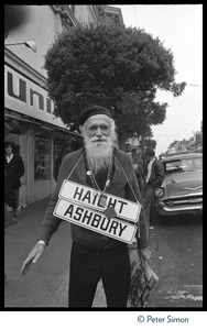 Thumbnail of Elderly bearded man with street signs for Haight and Ashbury Streets slung around             his neck