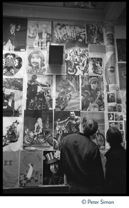 Thumbnail of Couple looking at posters for sale (Beatles, Jerry Garcia, motorcycles) in             Haight-Ashbury